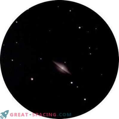 Поглед към галактиката Сомбреро от градовете